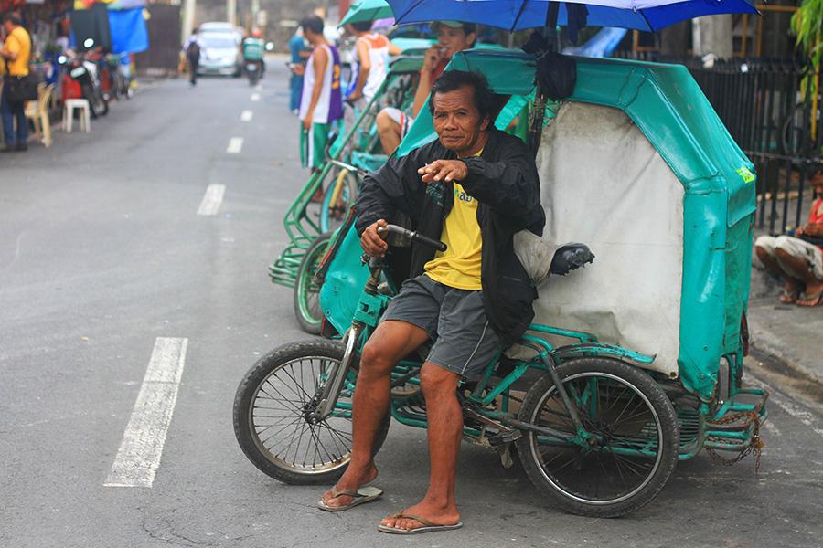 Triciyle, un moyen de transport courant à Manille.